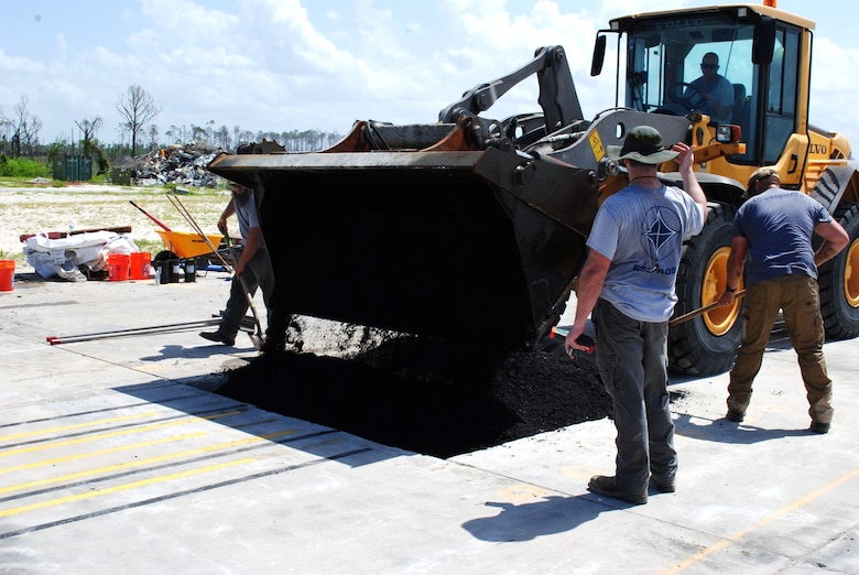 The pavements team with the Air Force Civil Engineer Center drops and evens out asphalt on top of the backfill material on July 16, 2019 at the 9700 Area at Tyndall Air Force Base, Florida. (U.S. Air Force photo by Grace Bland)