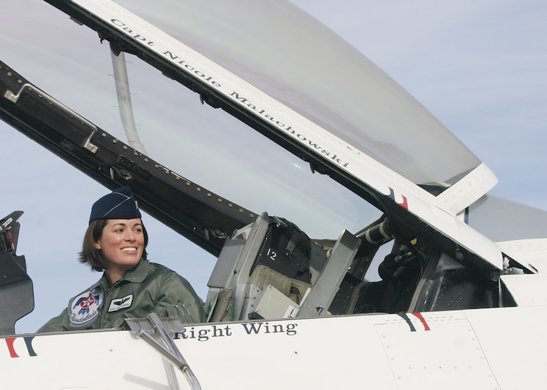 "Retired Col. Nicole ""FiFi"" Malachowski, in her F16-C Fighting Falcon during a Thunderbirds Air Demonstration, will visit Schriever Air Force Base Dec. 19. During her life, Malachowski has encountered multiple challenges that taught her that the spirit and desire for survival can be fed through the practice of mindfulness and internal motivation. (Courtesy photo)"