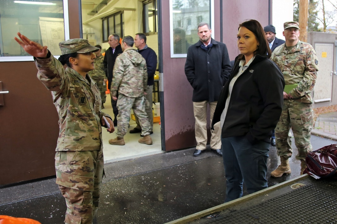 U.S. Army Reserve Sgt. 1st Class Saugat Brookshire, a survey team sergeant with the 773rd Civil Support Team, 7th Mission Support Command, explains how the survey team uses the survey operations trailer during missions to Dr. Brandi C. Vann, deputy assistant secretary of defense for U.S. Chemical and Biological Defense, while she tours the 773rd headquarters on Panzer Kaserne in Kaiserslautern, Germany, December 11, 2019. The 773rd is the only Civil Support Team in the U.S. Army Reserve and the European theater of operations. (U.S. Army Reserve photo by Sgt. 1st Class Joy Dulen)