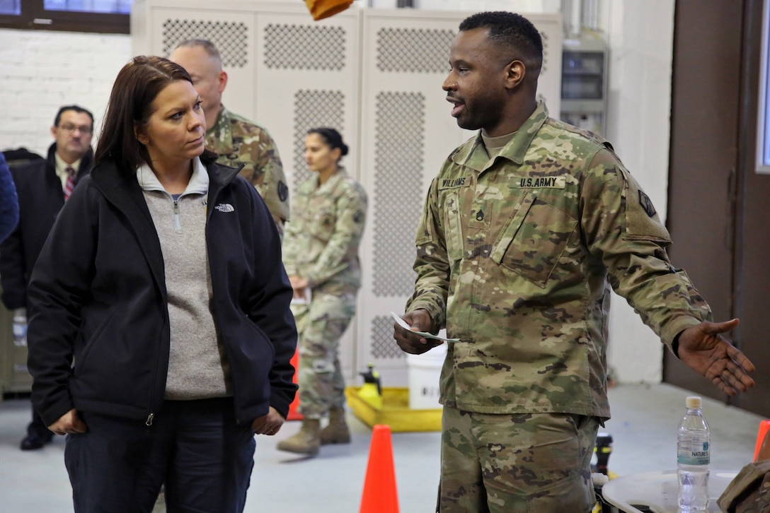 U.S. Army Reserve Staff Sgt. Antwon Williams, a human resources noncommissioned officer with the 773rd Civil Support Team, 7th Mission Support Command, explains decontamination capabilities to Dr. Brandi C. Vann, deputy assistant secretary of defense for U.S. Chemical and Biological Defense, while she tours the 773rd headquarters on Panzer Kaserne in Kaiserslautern, Germany, December 11, 2019. The 773rd is the only Civil Support Team in the U.S. Army Reserve and the European theater of operations. (U.S. Army Reserve photo by Sgt. 1st Class Joy Dulen)