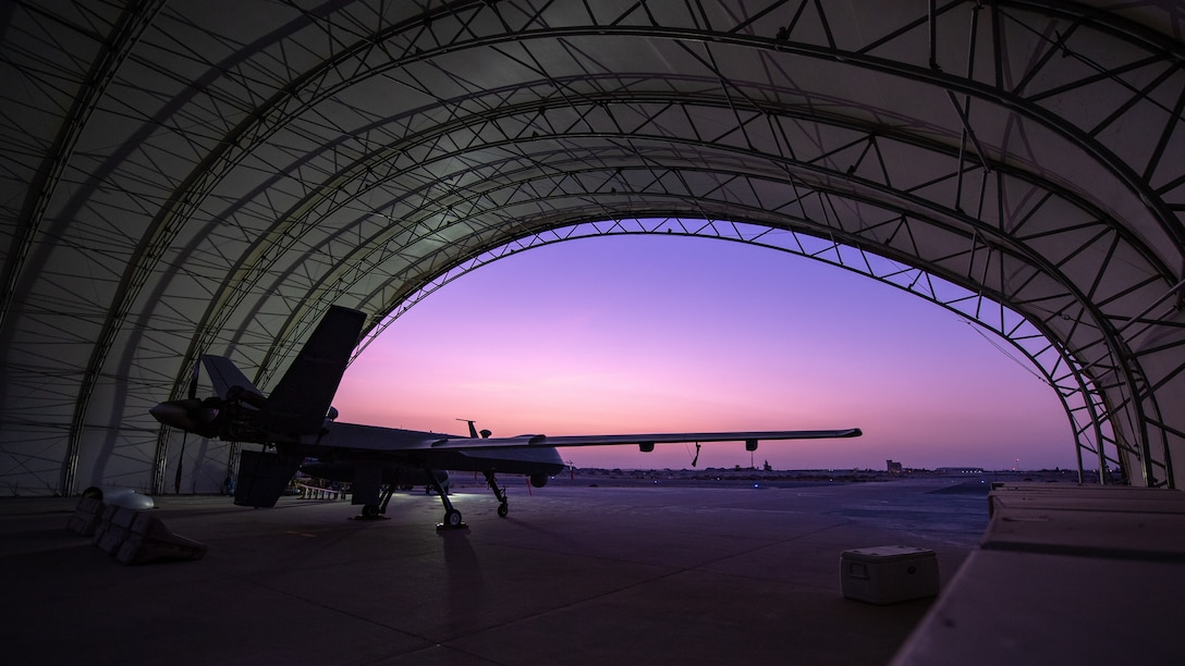 A U.S. Air Force MQ-9 Reaper remotely piloted aircraft awaits an engine test prior to Intelligence, Surveillance, and Reconnaissance operations at Ali Al Salem Air Base, Kuwait, July 23, 2019.