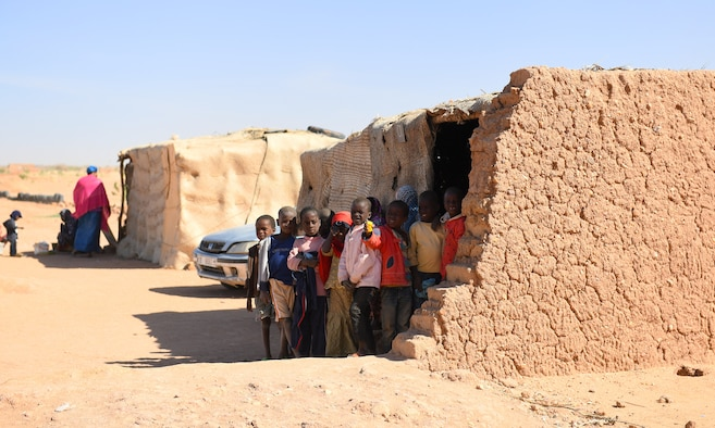 School children stand outside an older classroom in the village of Tadress, Niger, Dec. 12, 2019. Coordinated by members of the U.S. Army 443rd Civil Affairs Battalion CAT 219, Airmen deployed to the 724th Expeditionary Air Base Squadron Civil Engineer Flight, Nigerien Air Base 201, constructed a new classroom for the students. In Niger, a teacher is only assigned to a class if there is a building to teach in. (U.S. Air Force photo by Staff Sgt. Alex Fox Echols III)