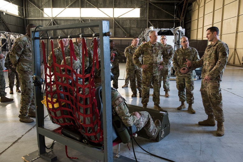 Maj. Gen. John Gordy, U.S. Air Force Expeditionary Center commander, and Chief Master Sgt. Kristopher Berg, USAF EC command chief, examine a High Altitude Airdrop Missions (HAAMS) equipment demonstration Dec. 11, 2019, at Joint Base Charleston, S.C. During their visit, Gordy and Berg toured various facilities across the installation for a behind-the-scenes look at base operations while getting a glimpse of service members in action. The USAF EC is the Air Force's center of excellence for rapid global mobility and agile combat support training and education. The center also has direct oversight for installation support, contingency response and mission sets within the global mobility enterprise.