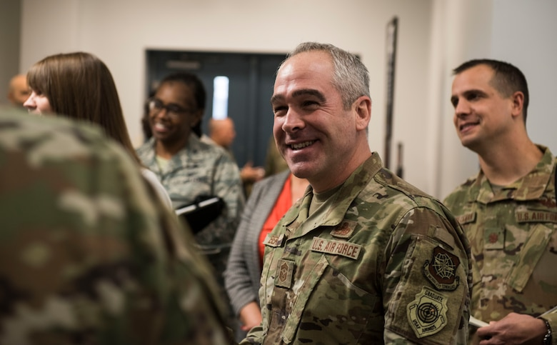 Chief Master Sgt. Kristopher Berg, U.S. Air Force Expeditionary Center command chief, learns about the base fitness center's plans and goals Dec. 11, 2019, at Joint Base Charleston, S.C. During the visit, EC leadership toured various facilities across the installation for a behind-the-scenes look at base operations while getting a glimpse of service members in action. The USAF EC is the Air Force's center of excellence for rapid global mobility and agile combat support training and education. The center also has direct oversight for installation support, contingency response and mission sets within the global mobility enterprise.