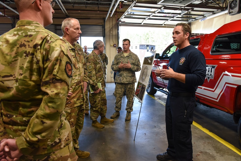 Maj. Gen. John Gordy, U.S. Air Force Expeditionary Center commander, and Chief Master Sgt. Kristopher Berg, USAF EC command chief, learn about the fire department's mission Dec. 10, 2019, at Joint Base Charleston, S.C. During their visit, Gordy and Berg toured various facilities across the installation for a behind-the-scenes look at base operations while getting a glimpse of service members in action. The USAF EC is the Air Force's center of excellence for rapid global mobility and agile combat support training and education. The center also has direct oversight for installation support, contingency response and mission sets within the global mobility enterprise.