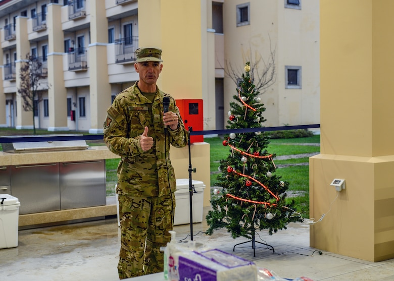 U.S. Air Force Brig. Gen. Daniel T. Lasica, 31st Fighter Wing commander, gives a speech for the grand opening of a new dorm pavilion at Aviano Air Base, Italy, Dec. 13, 2019. The pavilion was constructed for dorm Airmen to be able to relax and enjoy their free time. (U.S. Air Force photo by Airman Thomas S. Keisler IV)