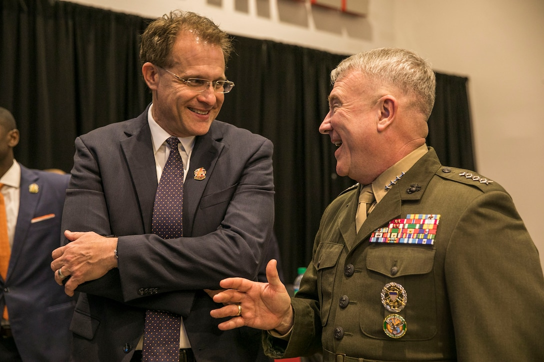 U.S. Marine Corps Gen. Kenneth F. McKenzie Jr., right, the commander of U.S. Central Command, speaks to Gus Malzahn, Auburn Tigers Head Football Coach, at Raymond James Stadium in Tampa, Florida, Dec. 12, 2019. (U.S. Marine Corps photo by Sgt. Roderick Jacquote)