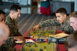 U.S. Marines with 3rd Marine Division play a game of Memoir 44' on Camp Schwab, Okinawa, Japan, Dec. 10, 2019. Memoir 44' is a war-themed strategy board game based on historical World War II battles. Wargaming is useful in generating, refining, and assessing concepts, plans, decision alternatives, issues and technologies. It also provides an opportunity to take risks, which is difficult to reproduce in experimentation, exercises or operations. (U.S. Marine Corps photo by Cpl. Timothy Hernandez)