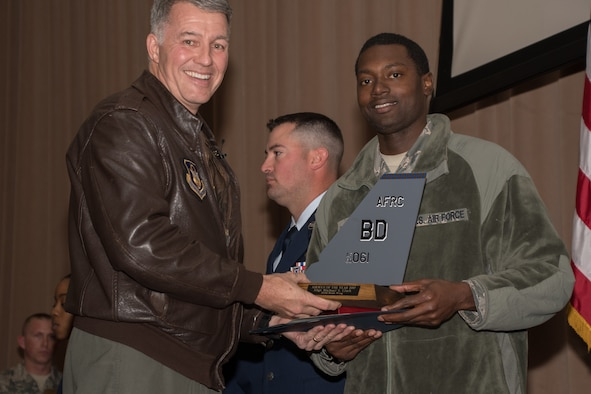 Photo of SSgt. Michael Clark accepting Airman of the Year award.