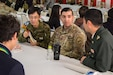 U.S. Army Reserve Spc. Robert Ramirez, assigned to the 364th Civil Affairs Brigade, fields questions about his military experience during a Japan Ground Self-Defense Force recruiting event held before Yama Sakura 77 in Camp Asaka, Japan, Dec. 8, 2019. The event offered local young people the chance to ask service members questions and hear how serving their country had changed their lives. (U.S. Army photo by Spc. John Weaver)