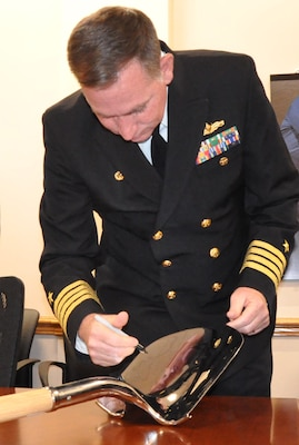 IMAGE: DAHLGREN, Va. (Dec. 12, 2019) – Naval Surface Warfare Center Dahlgren Division (NSWCDD) Commanding Officer Capt. Casey Plew signs a shovel prior to a groundbreaking ceremony for the new Cyber Warfare Engineering Laboratory. Plew broke ground with officials from NSWCDD, Naval Sea Systems Command, and CFM Engineering for the new facility that will provide a robust and flexible software and hardware testing capability for Department of Defense and Navy weapon systems, cyber and network platforms in addition to industrial control systems supporting DoD infrastructure. (Photo by U.S. Navy/Released)