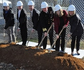 IMAGE: DAHLGREN, Va. (Dec. 12, 2019) – Navy officials, including Naval Surface Warfare Center Dahlgren Division (NSWCDD) leadership, break ground for the command's new Cyber Warfare Engineering Laboratory, Dec. 12. The facility will bring together the building blocks of existing capabilities into one place to provide a robust and flexible software and hardware testing capability for Department of Defense and Navy weapon systems, cyber and network platforms in addition to industrial control systems supporting DoD infrastructure. From left to right: Christopher Keener, NSWCDD cyber engineer; Darren Barnes, NSWCDD acting technical director; Scott St. Pierre, Enterprise Information Technology officer, Naval Sea Systems Command; Capt. Casey Plew, NSWCDD commanding officer; Shellie Clift, NSWCDD Strategic and Computing Systems Department head; Nancy Fitzgerald, principal, CFM Engineering. (Photo by U.S. Navy/Released)