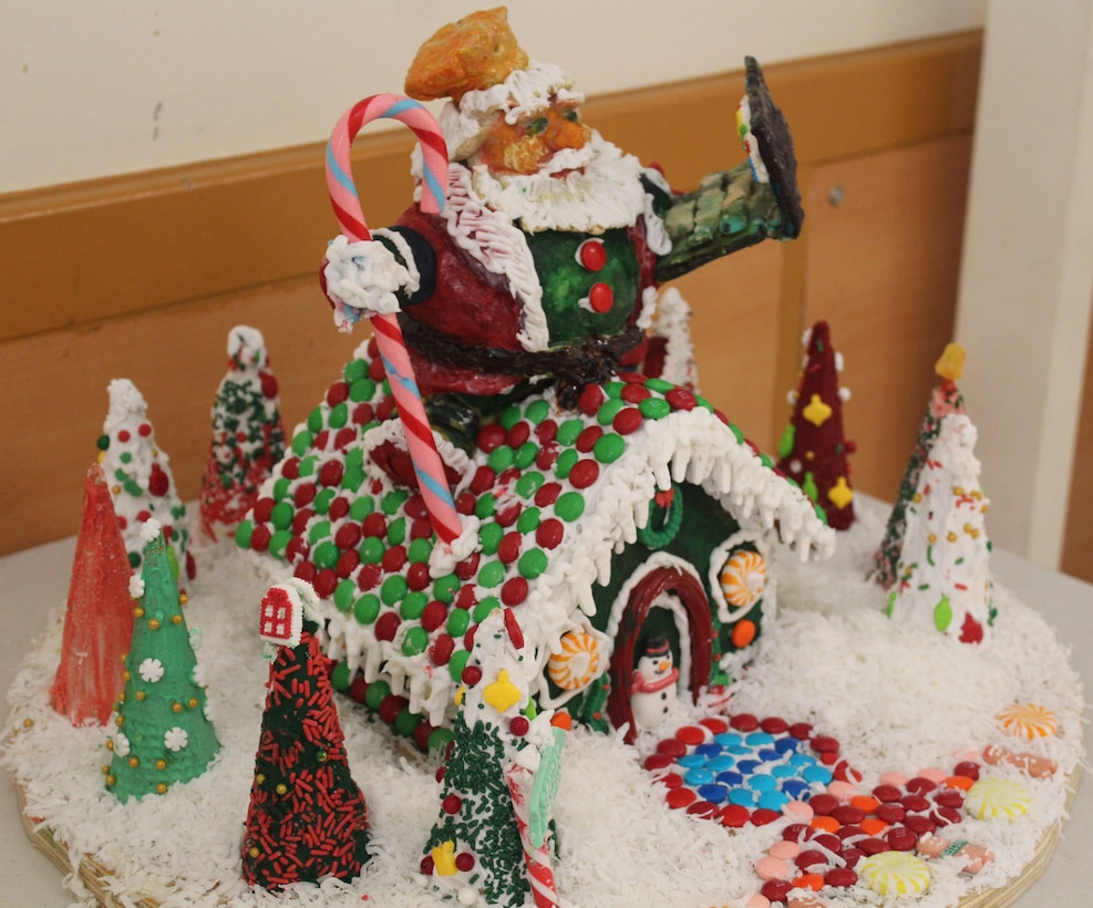 A winter scene depicted with a gingerbread house.