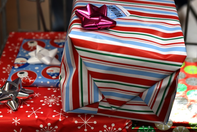 Newly wrapped presents at the Operation Blue Santa Shop with a Cop event sit ready to be taken home in San Angelo, Texas, Dec. 14, 2019. All of the wrapping supplies were provided through donations for the event. (U.S. Air Force photo by Senior Airman Seraiah Wolf)