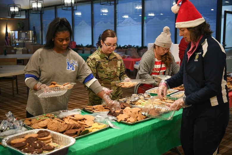 Volunteers pack up holiday cookies destined for various Airmen across Hill Air Force Base, Utah, Dec. 16, 2019, during the annual Team Hill Airmen Cookie Drive. Every year, volunteers bake, collect, package and deliver cookies to the base's Airmen. (U.S. Air Force photo by Cynthia Griggs)