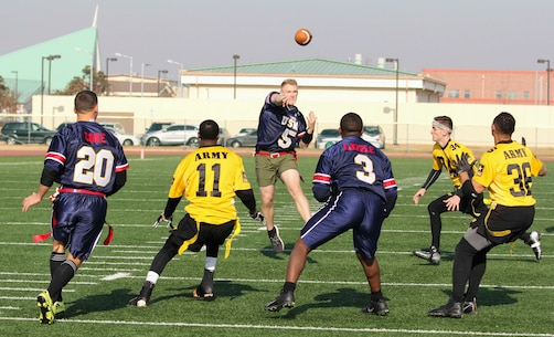Marines, Sailors, and Soldiers competed om the Army vs. Navy flag football game aboard USAG Camp Humphreys 24 December. The teams played head to head for a trophy and bragging rights, while building comradery between services. (U.S. Marine Corps photo by Sgt. Parker R. Golz)