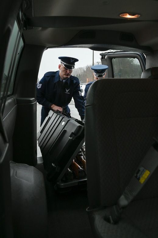 Tech. Sgt. Daniel Fox, left, and Tech. Sgt. Meldion Shehu, members of the Patriot Honor Guard at Hanscom Air Force Base, Mass., load equipment in a van for a military funeral detail in New York Dec. 9. Hanscom's Patriot Honor Guard provides funeral honor services in New England and Northeastern New York for active duty, retirees and veterans who served honorably in the United States Air Force. (U.S. Air Force photo by Mark Herlihy)