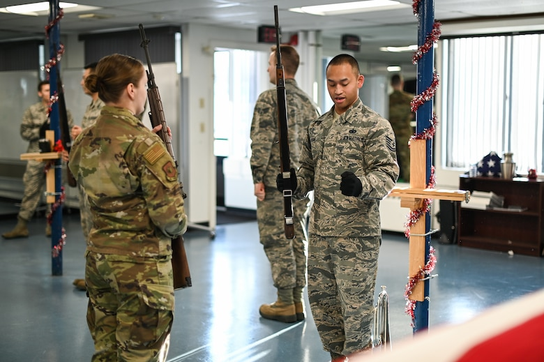 Tech. Sgt. David Seng, right, Patriot Honor Guard member, provides firing party instruction to 2nd Lt. Amanda Marciniak, an Honor Guard augmentee, during a training session at Hanscom Air Force Base, Mass., Dec. 12. The honor guard team provides funeral honor services in New England and Northeastern New York for active duty, retirees and veterans who served honorably in the United States Air Force. (U.S. Air Force photo by Mark Herlihy)