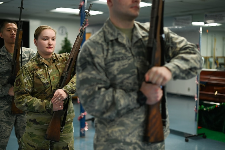 Second Lt. Amanda Marciniak, Patriot Honor Guard augmentee, practices with others during a training session at Hanscom Air Force Base, Mass., Dec. 12. The Patriot Honor Guard conducts training sessions each Thursday at their building for Airmen currently part of the augmentee program and those that are interested in joining the Honor Guard. (U.S. Air Force photo by Mark Herlihy)