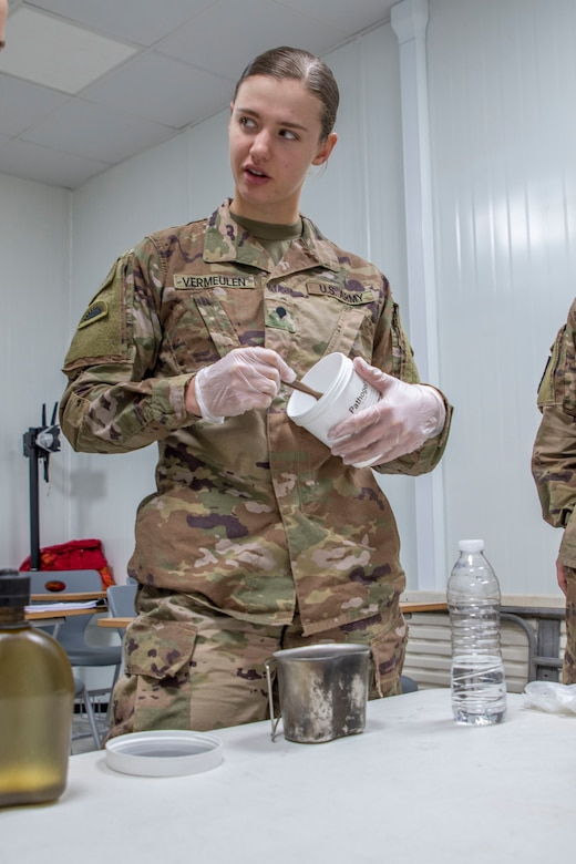 U.S. Army Spc. Shelby Vermeulen, with 1st Squadron, 303rd Cavalry Regiment, 96th Troop Command, Washington Army National Guard, works through the steps of water purification during a Field Sanitation Team Certification Course Dec. 9-13, 2019, at Joint Training Center-Jordan.