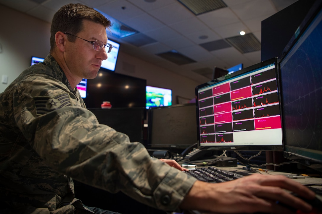 Tech. Sgt. Michael Vandenbosch, 22nd Space Operations Squadron defensive counter-space operator, uses software to identify interference to a specific satellite at Schriever Air Force Base, Colorado, Dec. 16, 2019. The DSCOs monitor signals from satellites to make sure they're clean and not corrupted. (U.S. Air Force photo by Airman 1st Class Jonathan Whitely)