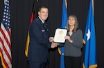 Air Force Brig. Gen. Mark August (left), 86th Airlift Wing commander presents a certificate to Isolde Hart, a German national employee with DLA Troop Support Europe & Africa, to recognize her 35 years of service during a ceremony Dec. 6 at Ramstein Air Base, Germany. Barbara Nagel, a contracting officer at DLA Troop Support Europe & Africa employee, also reached 35 years of service to the U.S. government.