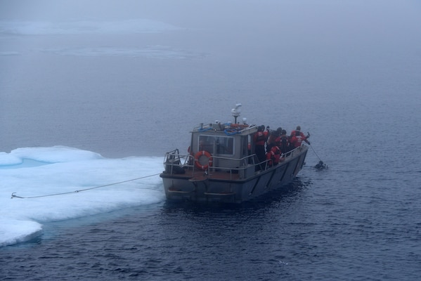 A small boat from the Coast Guard Cutter Healy is anchored to an ice floe during cold water ice dive operations in the Arctic Ocean, July 29, 2017. By conducting cold water ice dives in the Arctic and Antarctic, the Coast Guard has the ability to offer an adaptive force capability to the Polar Icebreaking fleet. U.S. Coast Guard photo by Senior Chief Petty Officer Rachel Polish