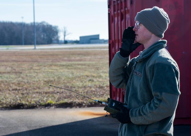 "Airman 1st Class Dalton Sawyer, 436th Logistics Readiness Squadron vehicle maintenance journeyman, yells ""fire in the hole"""