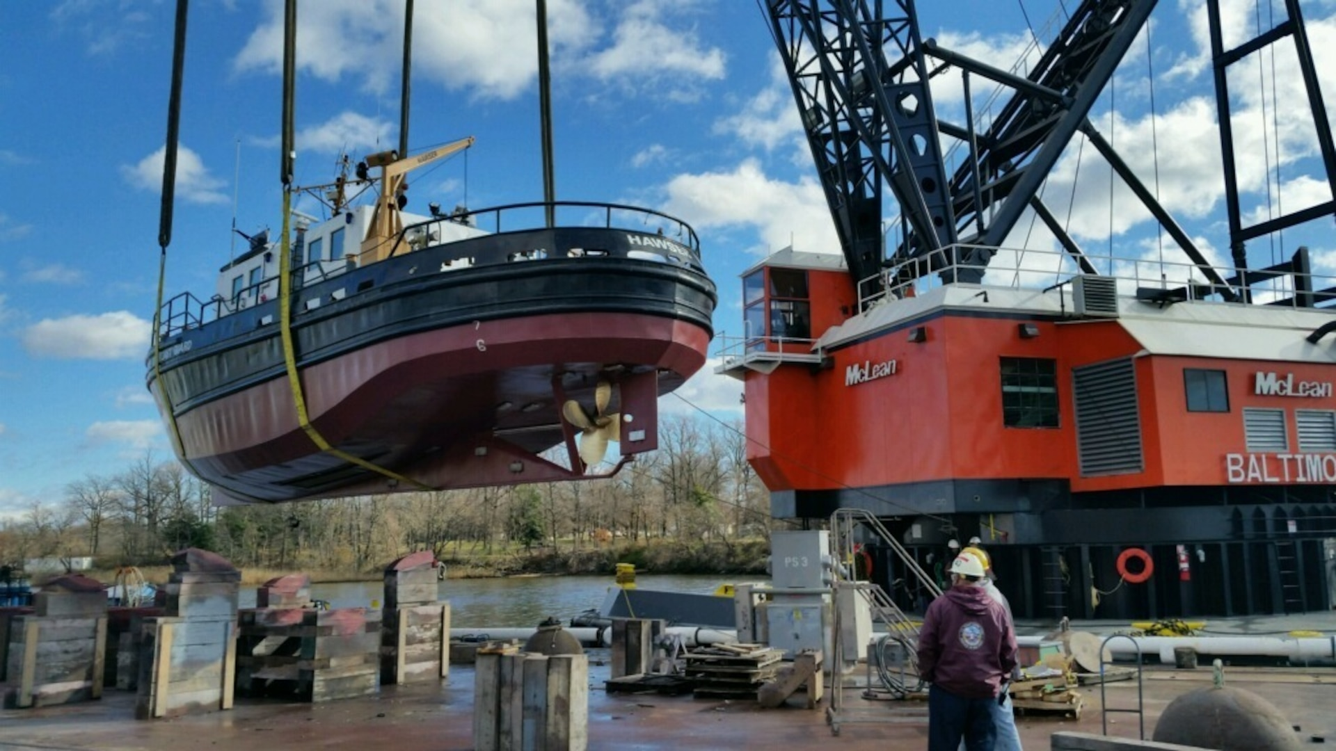 The Coast Guard Yard lifts the Coast Guard Cutter Hawser into the water to continue planned maintenance on the 65 foot small harbor tug home ported in Bayonne, N.J. Service to the fleet!