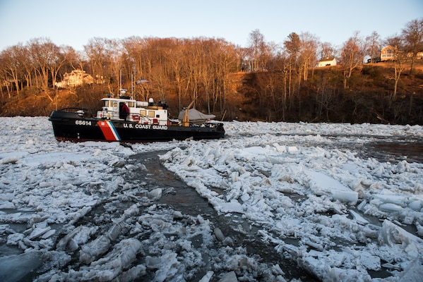 U.S. Coast Guard Cutter Bollard, a 65-foot Small Harbor Tug, transits on the ice-covered Connecticut River near Essex, Connecticut, Jan. 18, 2018. The Bollard is being used on the Connecticut River to break apart ice jams causing floods along the Connecticut River in support of Operation - Reliable Energy for Northeast Winters (RENEW). (U.S. Coast Guard photo by Petty Officer 3rd Class Frank Iannazzo-Simmons)