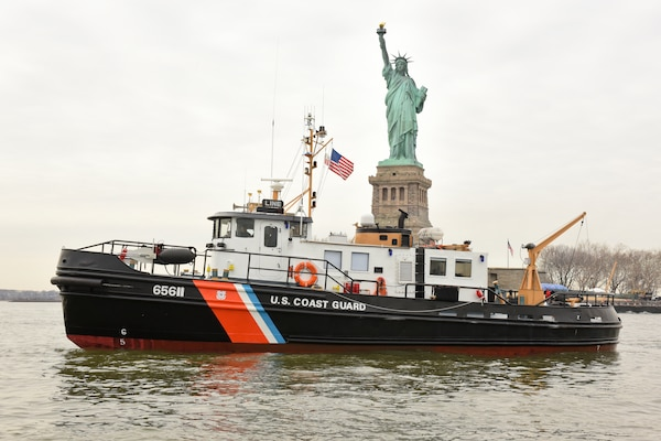Coast Guard Cutter Line, a 65-foot small harbor tug, sits in the Upper Bay of New York Harbor near the Statue of Liberty, February 6, 2018. The Line is an homeported in Bayonne, New Jersey, and is one of 11 small ice breaking tugs. (U.S. Coast Guard photo by Petty Officer 3rd Class Steve Strohmaier)