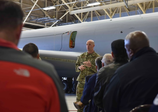 U.S. Air Force Col. Larry Gardner, 141st Air Refueling Wing commander, welcomes members from the Department of Defense Maintenance Symposium to Fairchild Air Force Base, Washington, Dec 12, 2019. Team Fairchild hosted a DoD Maintenance Symposium tour to showcase Condition Base Maintenance Plus, Theory of Constraints and innovations implemented. (U.S. Air Force photo by Airman 1st Class Kiaundra Miller)