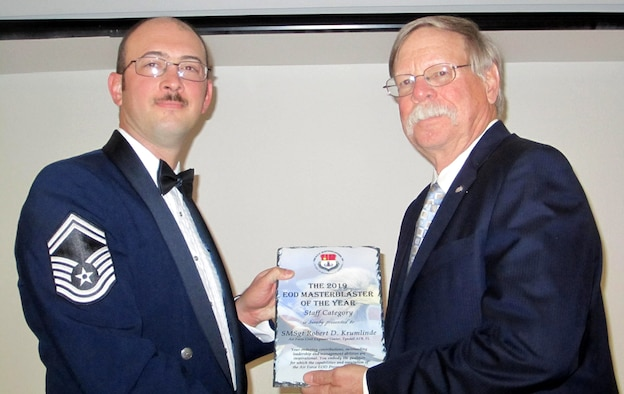 Senior Master Sgt. Robert D. Krumlinde, left, EOD Force Development manager, Air Force Civil Engineer Center, receives this year's Staff Level Master Blaster award, at a ceremony held near Tyndall Air Force Base, Fla., Nov. 9, 2019.