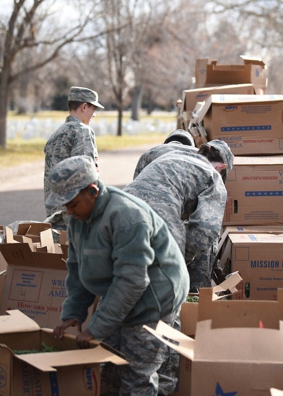 Cadets from Civil Air Patrol Mile High Squadron 143 sort wreaths for the Wreaths Across America event at Fairmount Cemetery in Denver, Dec. 14, 2019.