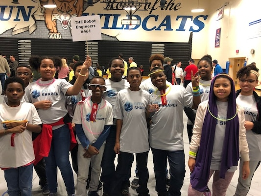 IMAGE: RICHMOND, Va. (Nov. 23, 2019) - Members of the FIRST Lego League team called 'The Robot Engineers' are pictured during the Glen Allen Regional Tournament held at Deep Run High School. The team – comprising ten grade-school students from multiple public and home-school districts in metro-Richmond – received the first place Innovation Project Award for their solution to combat homelessness. Naval Surface Warfare Center Dahlgren Division employees Serita Seright, Joycelyn Josey-Harris and Tiffany Owens helped mentor the team.
