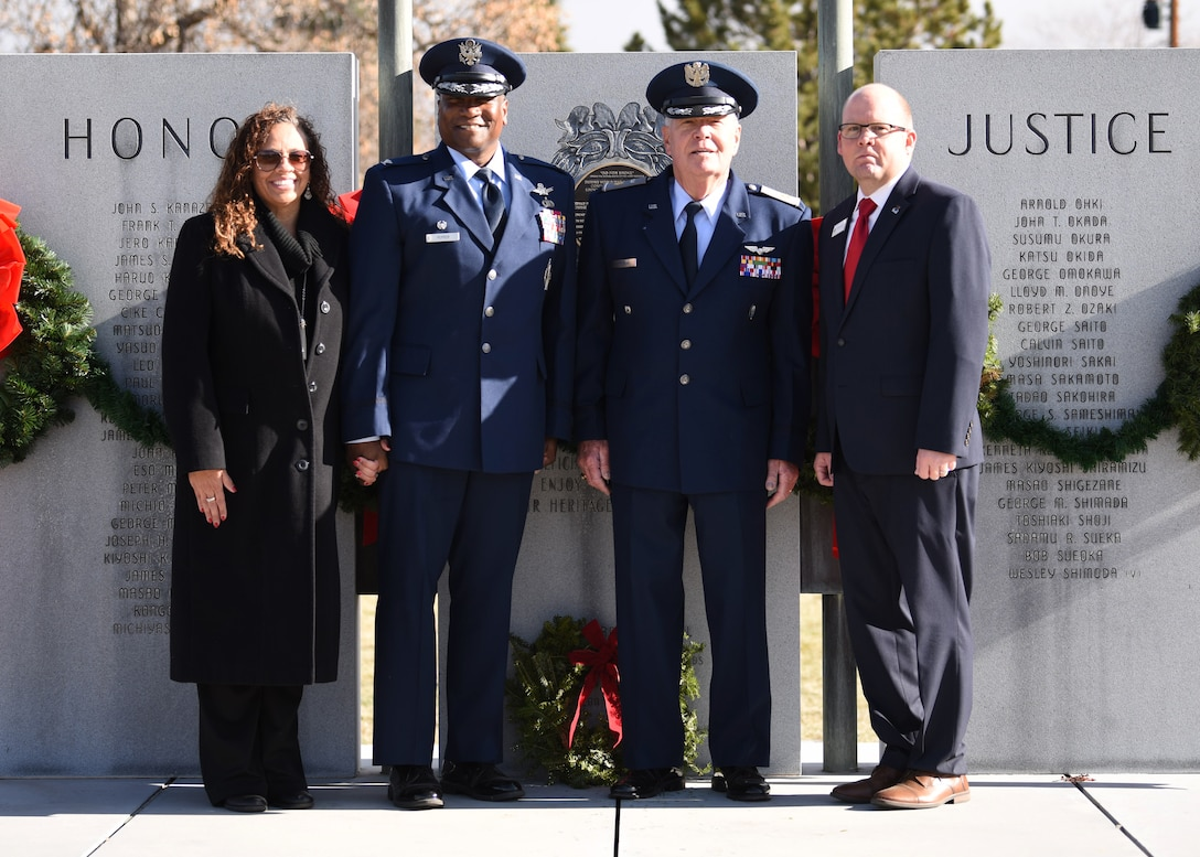 From left to right, Alicia Pepper, 460th Space Wing commander's spouse, Col. Devin Pepper, 460th SW commander, Maj. Norm Teltow, Civil Air Patrol Mile High Squadron 143 commander, and Michael Long, Fairmount Cemetery director of business development, pose in front of a monument at Fairmount Cemetery in Denver, Dec. 14, 2019.