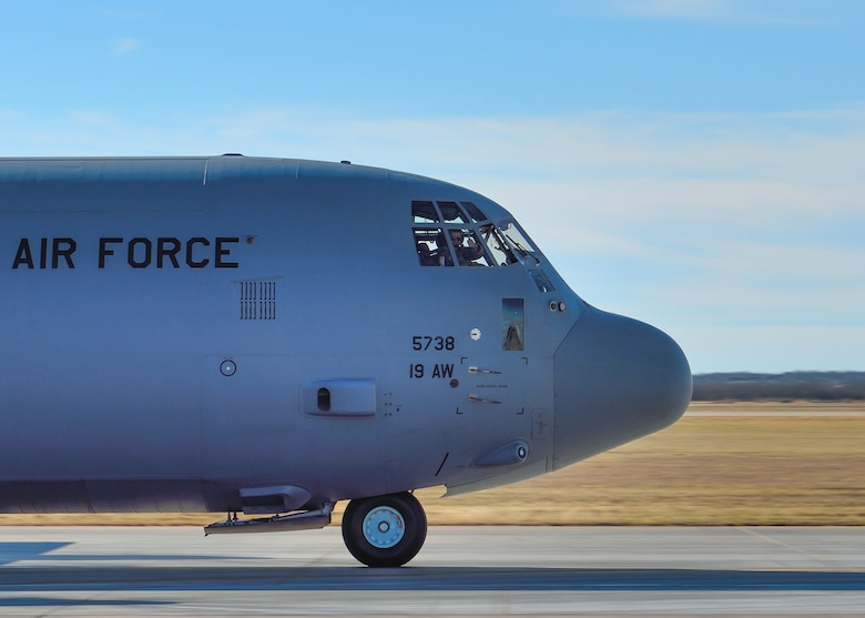 a C-130 takes off