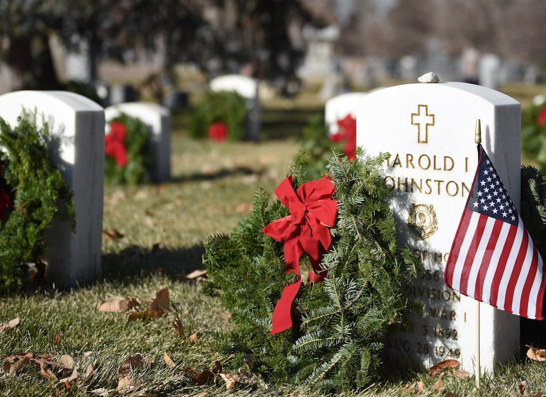 Volunteers placed wreaths on the graves of fallen service members at the Wreaths Across America event at Fairmount Cemetery in Denver, Dec. 14, 2019.