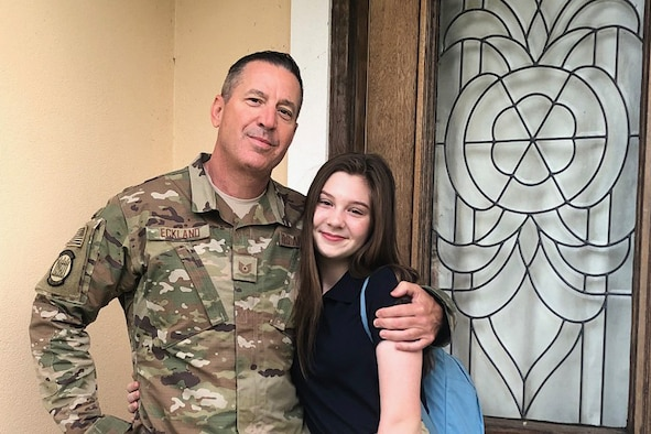 Tech. Sgt. Krekel Eckland, 41st Aerial Port Squadron air transportation specialist, poses for a photo with his daughter. (U.S. Air Force courtesy photo submitted by Tech.Sgt. Krekel Eckland, cropped photo)
