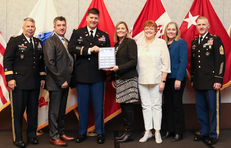 During the 2019 Society of American Military Engineers Federal Small Business Conference Excellence in Contracting Awards Program Nov. 21, 2019 in Dallas, Texas, Lt. Gen. Todd Semonite (left), Commanding General of the U.S. Army Corps of Engineers, and USACE Command Sgt. Maj. Bradley Houston (right) presented Jeff Roberts, Huntsville Center contracting; Col. Marvin Griffin, Huntsville Center commander; Brandy Percell, Huntsville Center Office of Small Business Initiative; Colleen O'Keefe, Huntsville Center Contracting chief and Kristina Freese, Huntsville Center Business Director, with three Top Dollar awards. The Center took 1st Place in Small Business ($790 million), 1st Place in Small Disadvantaged Business ($416 million) and 2nd Place in Service Disabled Veteran Owned Small Business ($98.6 million.) Over the last decade, Huntsville Center contracts have allocated more than $6 billion to small business for their services in supporting the Center's global mission.