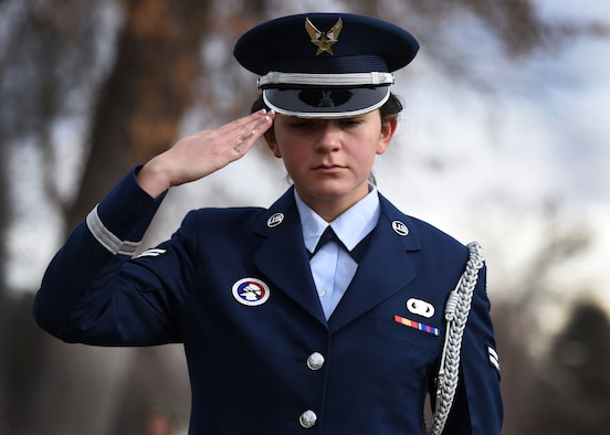 Airman 1st Class Tiffany Rios, Mile High Honor Guard ceremonial guardsman, renders a salute after placing a wreath on a veteran's grave at the Wreaths Across America (WAA) event at Fairmount Cemetery in Denver, Dec. 14, 2019.