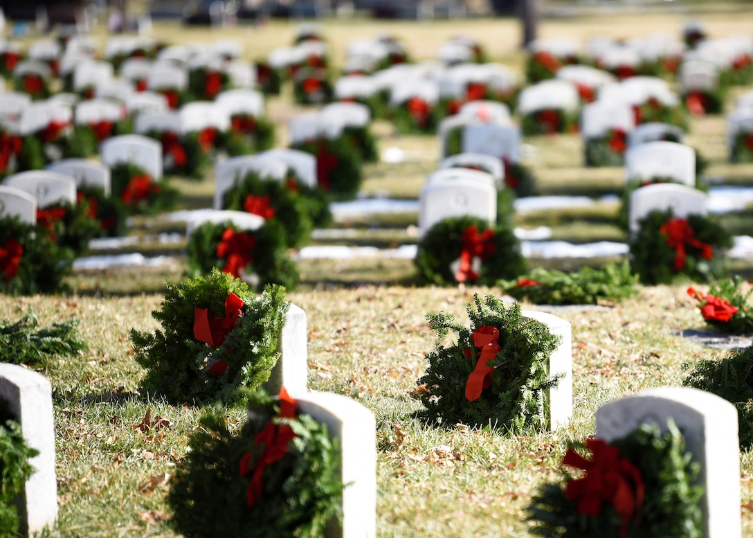 Wreaths are placed on the graves of departed veterans at Fairmount Cemetery in Denver, Dec. 14, 2019.