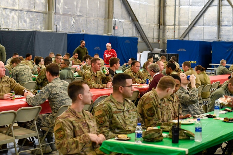 Airmen converse during the Feed the Troops event at Dover Air Force Base, Del., Dec. 17, 2019. Each year Airmen attend the community-sponsored event, which started in 2004. (U.S. Air Force photo by Senior Airman Eric M. Fisher)