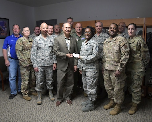 The Air Force Sergeants Association gave the Dobbins Chiefs Group a check for $300 on Dec. 6, 2019. The donation will go toward the Dobbins Chiefs Group Scholarship as well as other programs related to morale and welfare of enlisted Airmen at Dobbins, said Chief Master Sergeant Stephanie Gillis, 700th Airlift Squadron operations superintendent. (U.S. Air Force photo/Tech. Sgt. Andrew Park)