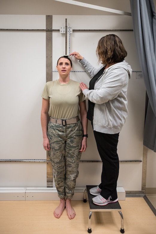 Jessica Barker, an aeromedical technician at the U.S. Air Force School of Aerospace Medicine, measures the standing height of a pilot candidate using the only official anthropometric device for measuring those who fall outside height standards. Seven measurements are collected and uploaded into a waiver system to determine if height for each candidate is truly an eliminating factor to fly manned aircraft. (U.S. Air Force photo by Richard Eldridge)