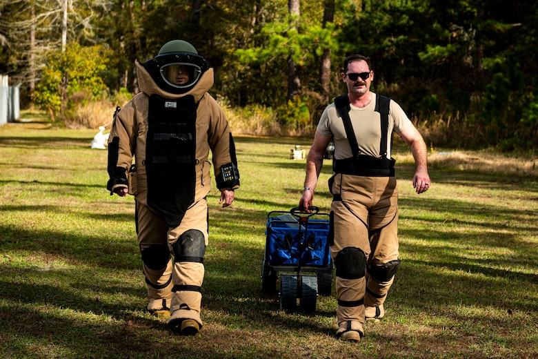 A photo of Airmen walking away from a training IED.