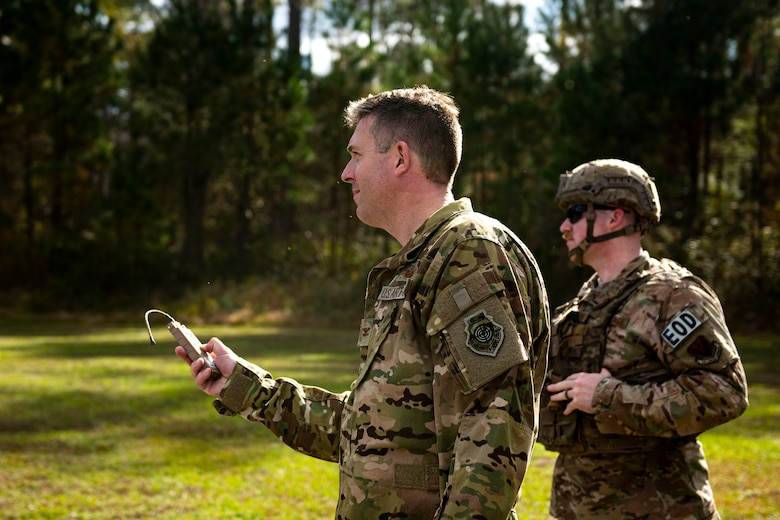 A photo of Col. Dan Walls remotely firing a percussion actuated neutralizer.