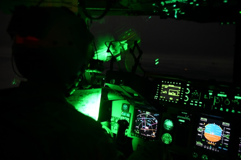 A person sits in the cockpit of an aircraft.