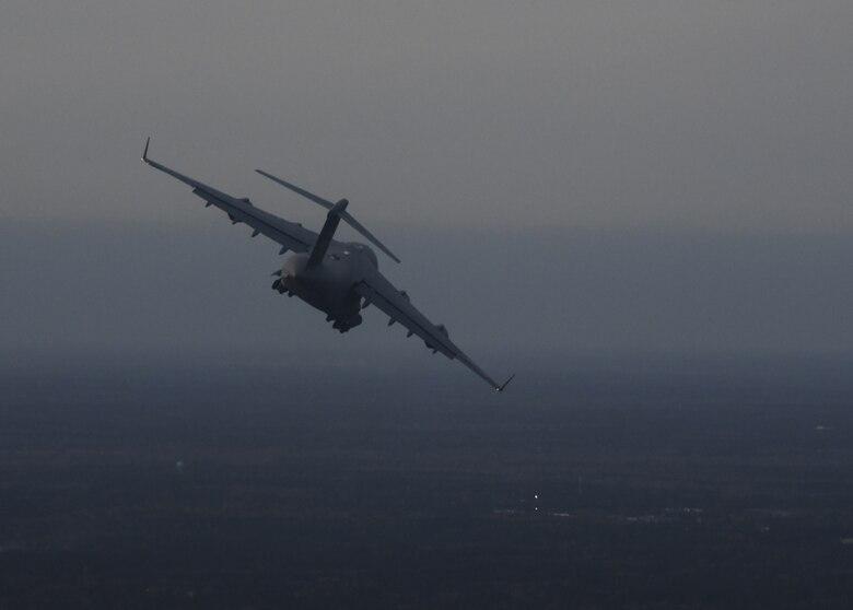An aircraft flies in the sky.