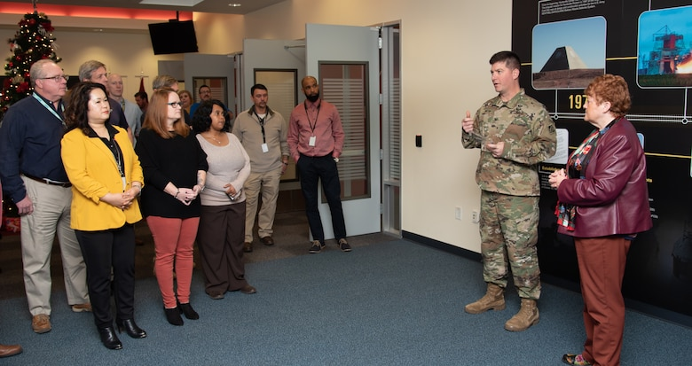 "Col. Marvin L. Griffin, second from right, commander of the U.S. Army Engineering and Support Center, Huntsville, Alabama, thanks members of the Fuels Recurring Maintenance and Minor Repair Project Delivery Team Dec. 16, 2019, for the hard work that earned them the 2019 U.S. Army Corps of Engineers' ""Team of the Year"" Excellence in Contracting Award, which Griffin presented to the team. At right is Colleen O'Keefe, who leads the Contracting Directorate at Huntsville Center."